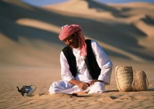 Beduine Man standing in the Desert