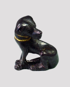 Figurine of a dog made of bronze with a gold collar