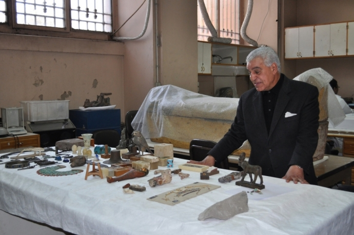 Dr. Zahi standing in front of objects in the conservation lab in the Egyptian Mueum, Cairo. (PHOTO: Stephanie Sakoutis)